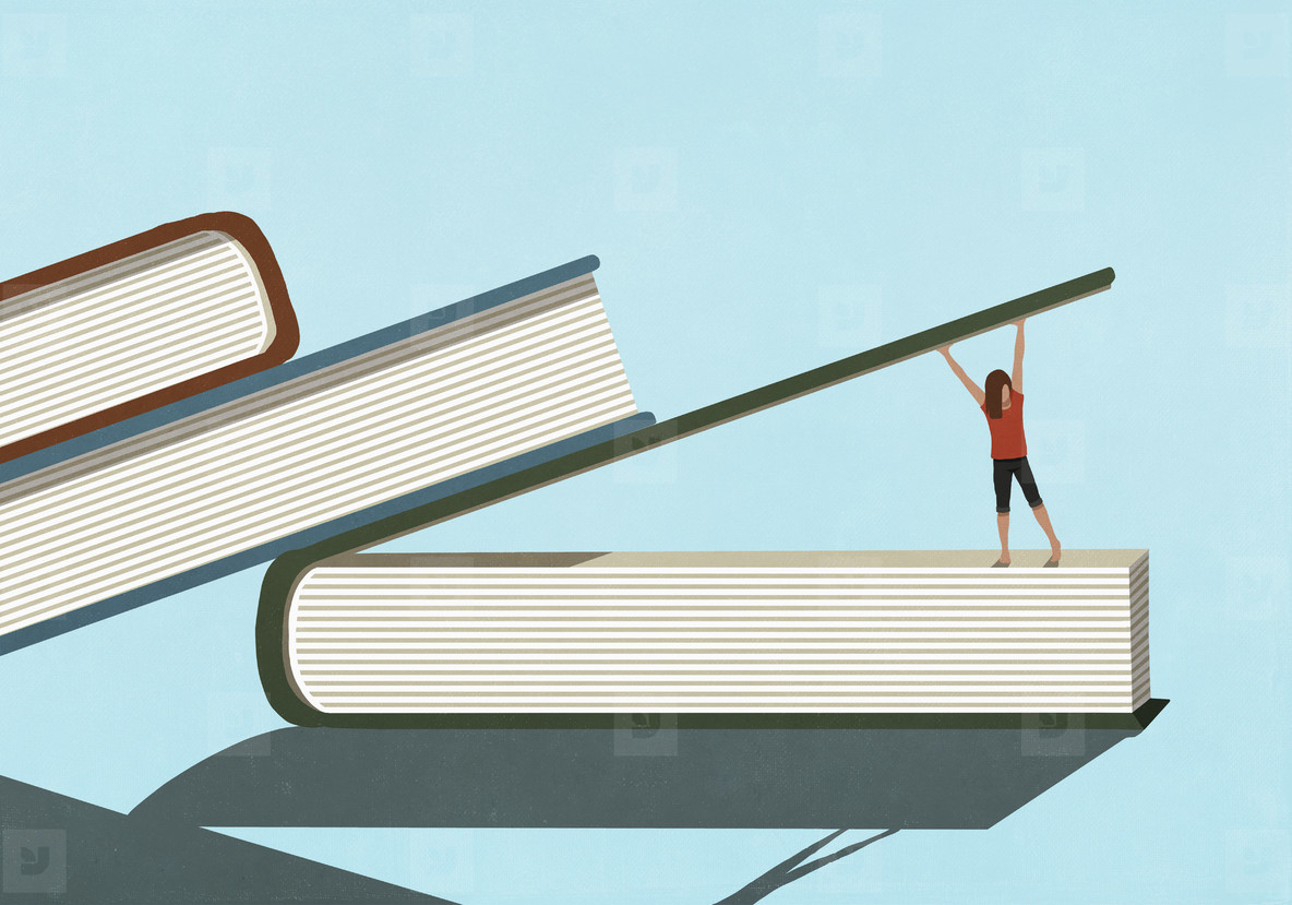 Woman lifting large book cover