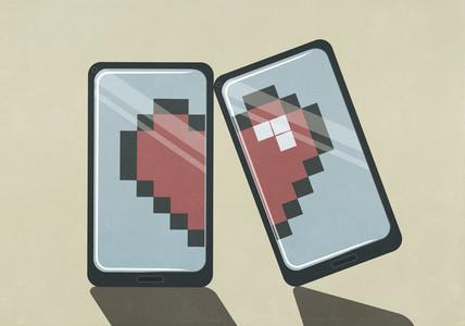 Pixelated broken heart on smart phone screens