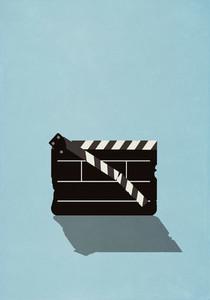 Dilapidated film slate on blue background