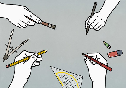 Creative hands holding writing devices