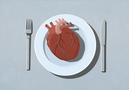 Human heart organ on dinner plate