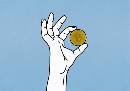 Close up hand holding Bitcoin on blue background