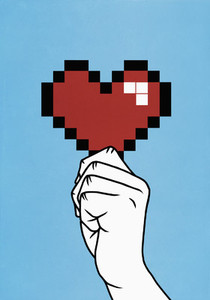 Close up hand holding pixelated heart