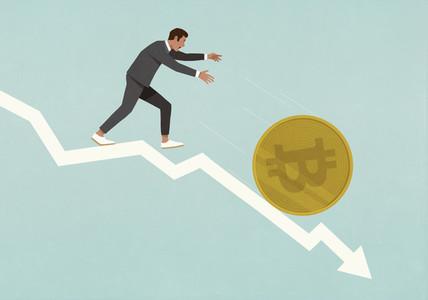 Businessman chasing Bitcoin falling down descending arrow