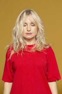 Portrait serene blonde woman meditating with eyes closed