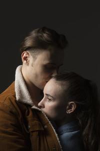 Studio portrait affectionate young couple
