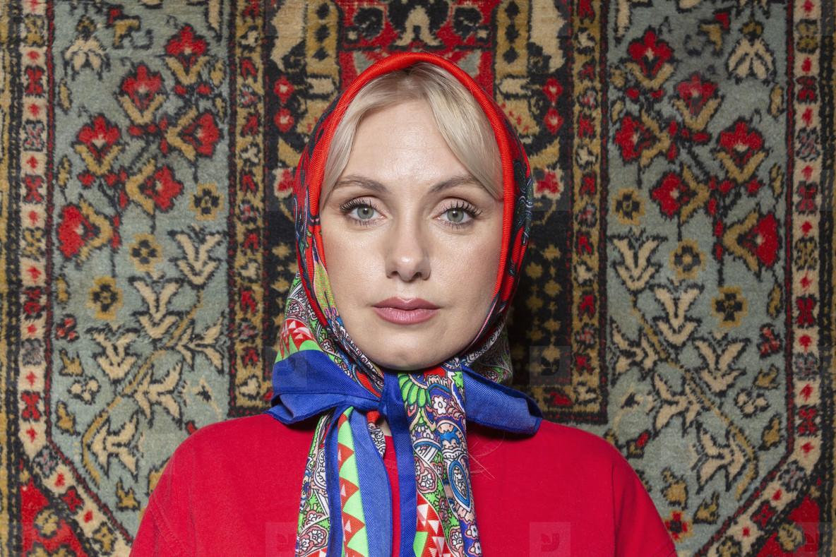 Portrait beautiful woman in colorful babushka