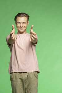 Portrait excited young man with arms outstretched