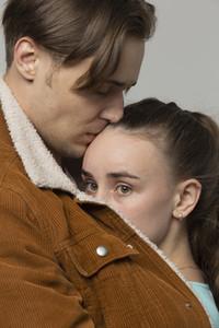Close up boyfriend comforting worried girlfriend
