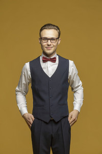 Studio portrait handsome young man in suit and bow tie