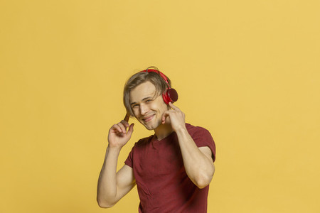 Portrait happy young man listening to music with headphones
