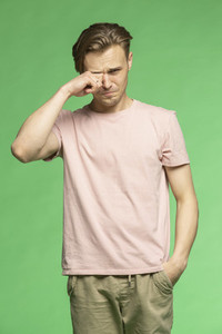 Studio portrait unhappy young man crying