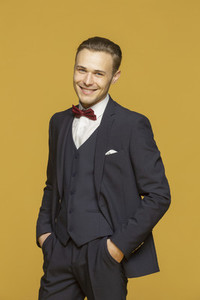 Portrait handsome young man in three piece suit