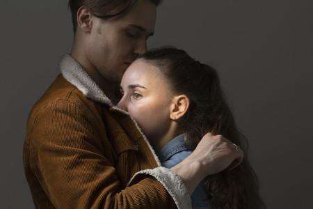 Boyfriend hugging worried girlfriend