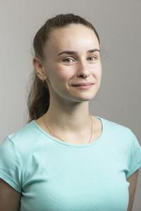 Studio portrait confident young woman