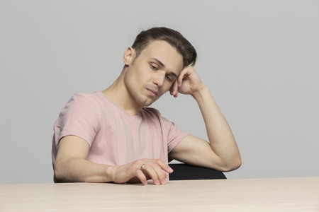 Worried young man thinking