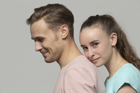 Studio portrait confident young couple