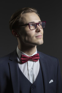 Portrait thoughtful handsome young man in suit and eyeglasses