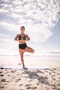 Tree pose yoga meditation on the beach