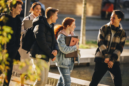 Young people walking outside after class