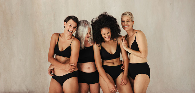 Laughing women of different ages