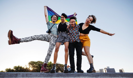 Group of young queer people celebrating pride together