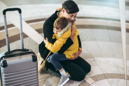 Mother getting emotional with her child at airport