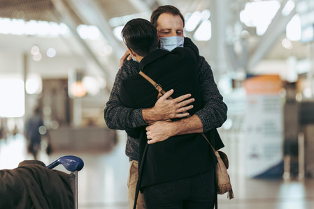 Man meeting his girlfriend in the airport