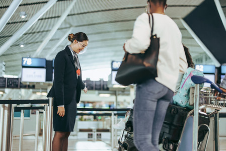 Airport attendant helping tourist family