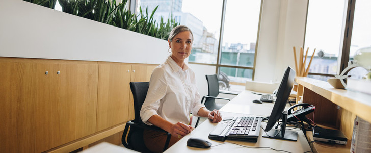 Receptionist at front desk in office