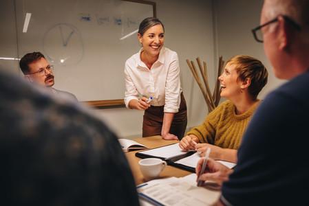 Woman leading boardroom meeting