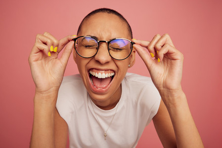 Excited and expressive creative woman wearing eyeglasses