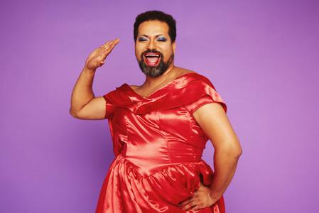 Drag performer singing in female clothing