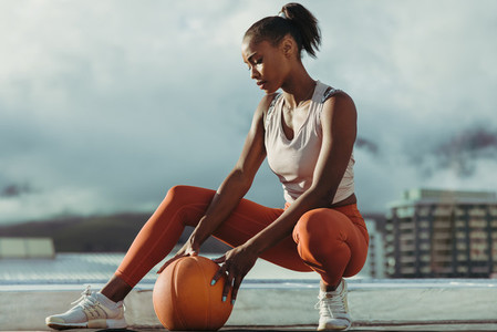 Fitness woman relaxing after exercising session