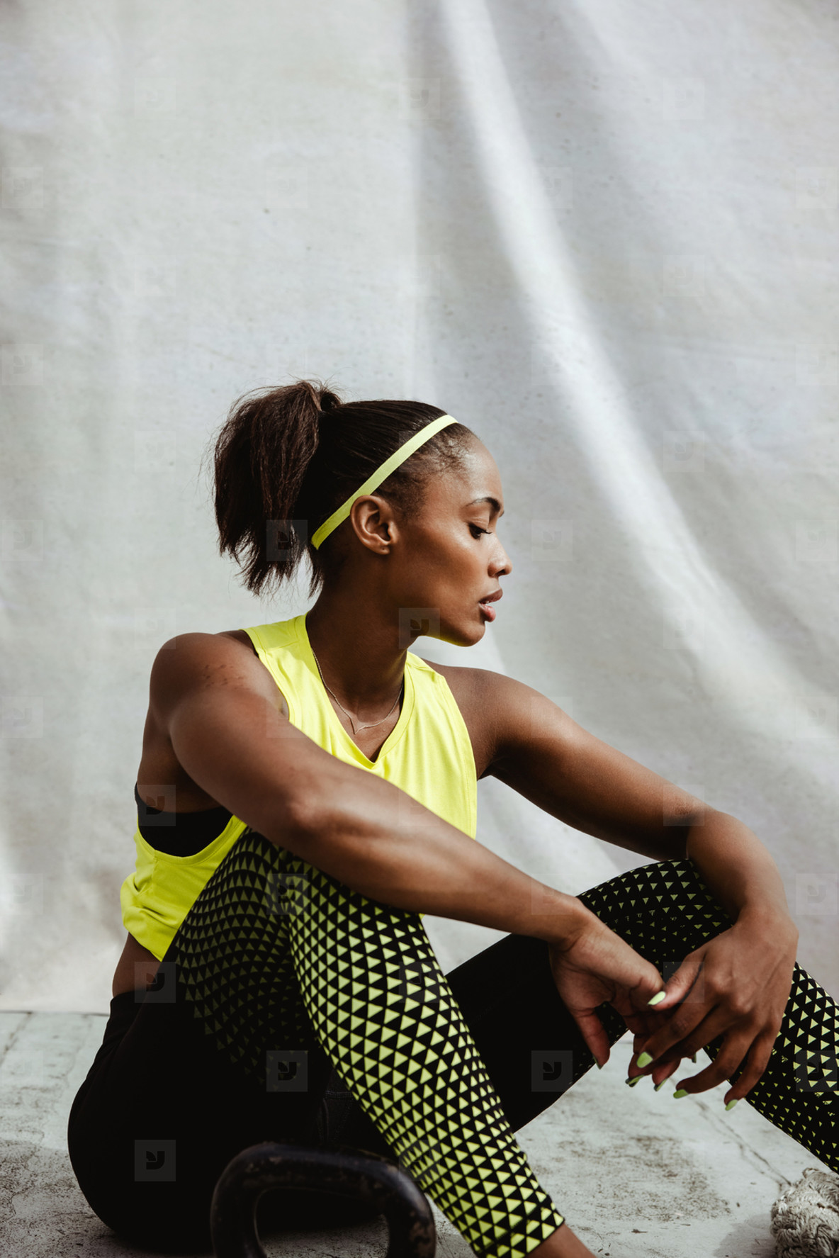 African woman feeling tired after workout