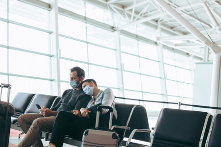 Couple waiting for delayed flight at airport