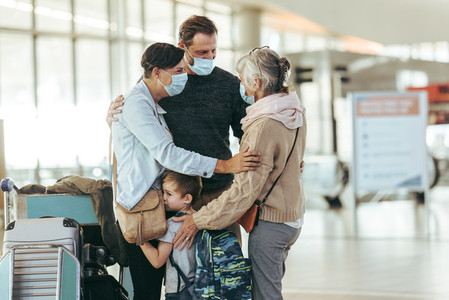 Family reunion at airport after pandemic