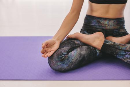 Woman in yoga class meditating