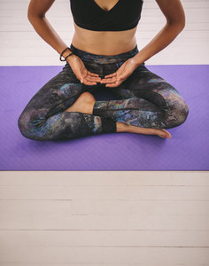 Female meditating at fitness class