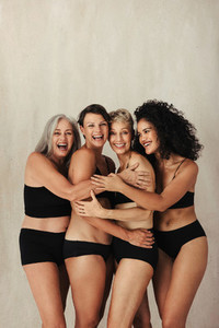 Smiling group of natural and diverse women