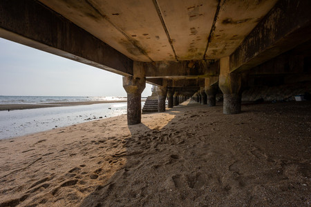 Under the walkway of Bangsaen Beach in the evening time  very fe