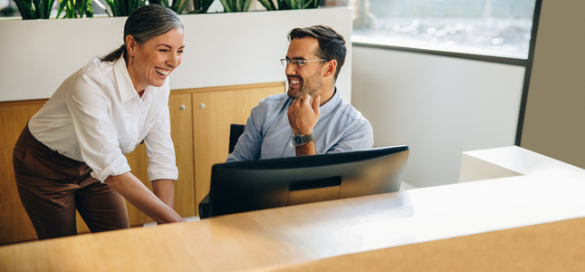 Two business people working together on computer