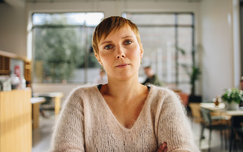 Young woman standing in coworking office