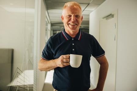 Businessman having coffee break