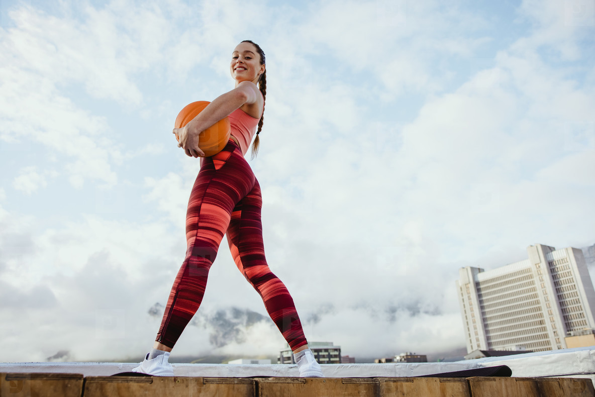 Fitness woman with basketball