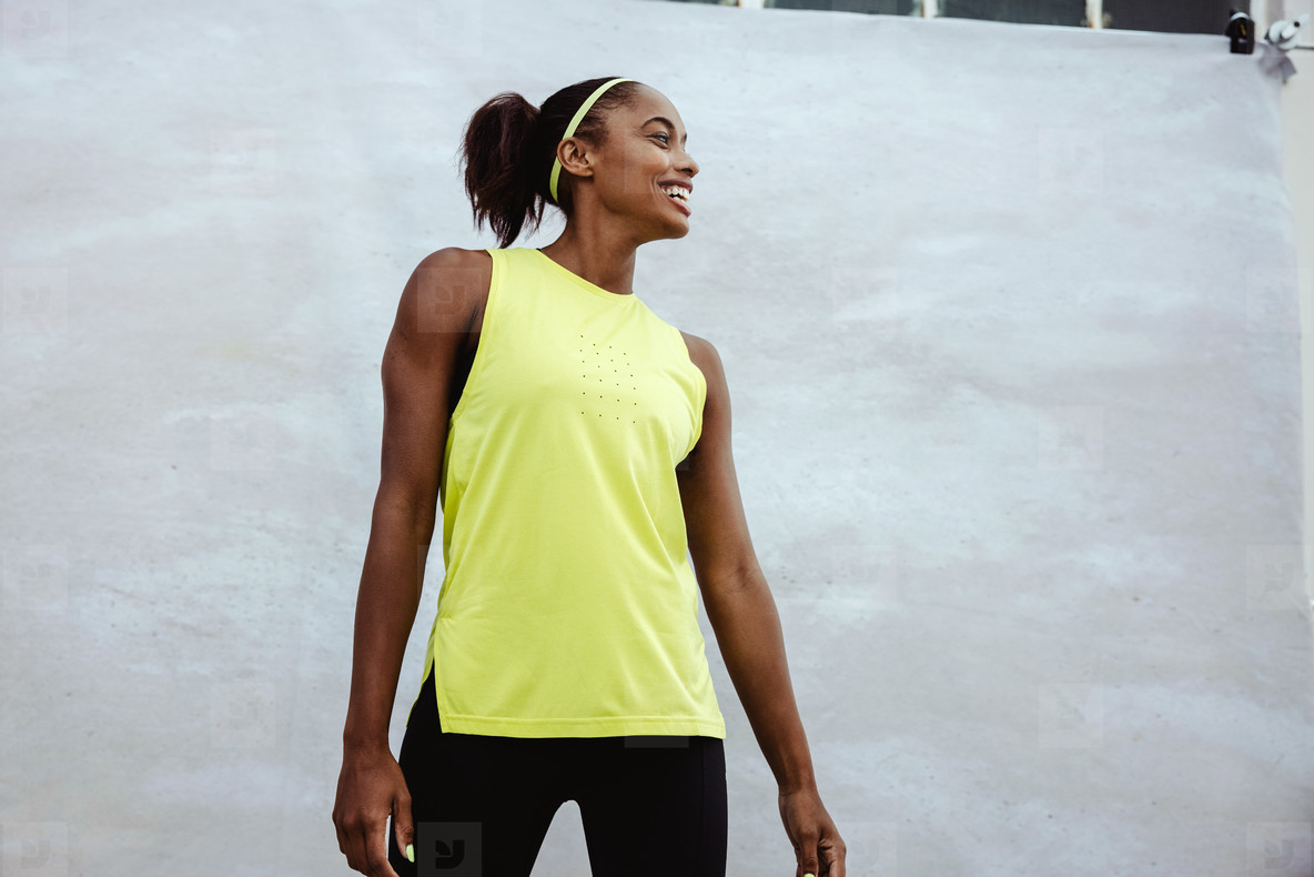 Smiling fitness woman on white background