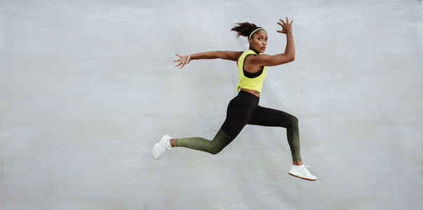 Fitness woman jumping