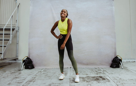 African woman taking a break from workout