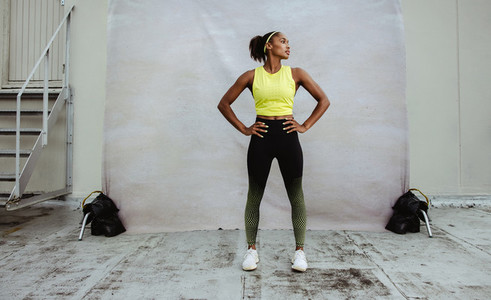 African sportswoman looking away after workout