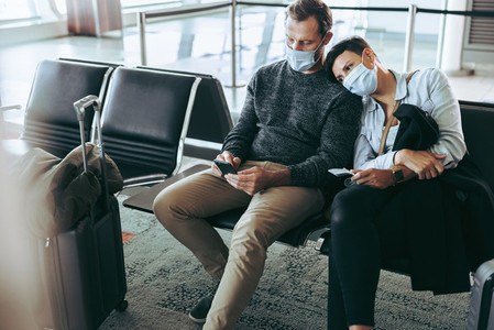 Couple waiting for delayed flight during pandemic lockdown